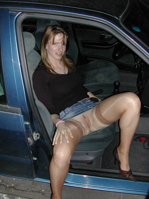 ... wearing tan stockings, takes her pants off in the… | Interracial Sex